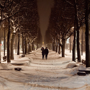 Midnight strollers wander up Laisvės Alėja   in a snowstorm